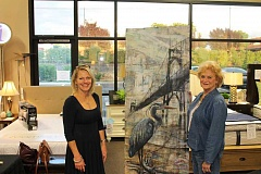 SPOKESMAN PHOTO: ANDREW KILSTROM - Trudy Palo, left, owner of Trudy's Living Room, and Carol Torres stand next to a painting done by Wilsonville High School Art Director Christopher Shotola-Hardt.