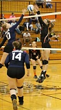 JIM BESEDA/MOLALLA PIONEER - Molalla's Sabrina VanSmoorenburg blocks a shot by Stayton's Madison Anderson during Tuesday's non-conference volleyball match at Capasso Court.