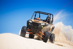 COURTESY BRUCE W. SMITH - With its racing-type suspension and power, the new 2016 RZR XP Turbo EPS ATV is right at home in Oregon's dune playgrounds.