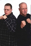 SUBMITTED PHOTO - Terry Mathews and his son, Trevor, demonstrate boxing stances for the Mathews Box N Fit studio opening this weekend.
