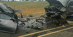 OSP - A 21-year-old Woodburn woman died when her car hit a pickup truck head-on on HIghway 211 near Molalla Monday.