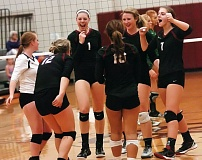 DAN BROOD - The Sherwood High School volleyball team celebrates after scoring a point in its match with Tigard.