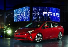 TRIBUNE PHOTO: JOHN M. VINCENT - The 2016 Toyota Prius rolls onstage for its world debut in Las Vegas. The new 4-door is longer, wider and a bit lower than the car it replaces. It's also expected to be about 10 percent more efficient.