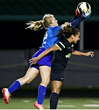 JAIME VALDEZ - Clackamas sophomore goalkeeper Kendall Rooney leaps high over Jesuit forward Salyna Blue to make a save in last weeks game with the Crusaders.