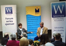 TIMES PHOTO: JAIME VALDEZ - Reps. Suzanne Bonamici and Kurt Schrader speak at a Westside Economic Alliance event in the event center at Portland Community College's Rock Creek campus Tuesday morning.