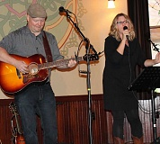 SPOKESMAN PHOTO: ANDREW KILSTROM - Tim Ellis and Michelle Van Kleef provided music at Lowrie Primary's Benefit Concert at McMenamins Tuesday, Sept. 15.