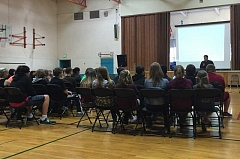 POST PHOTO: KYLIE WRAY - Cody Welty takes the time to interact one on one with Cedar Ridge students and answer their questions about dealing with depression.