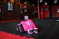 POST PHOTO: KYLIE WRAY - 9Round offers pink wraps and boxing gloves, an appropriate accessory for its October Breast Cancer Awareness Kick Event.