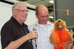 HOLLY M. GILL - Bill Houts, left, an avid Oregon State Beaver fan, presents Community Champion Rick Allen, an avid University of Oregon Ducks fan, with a stuffed Beaver, at the Chamber of Commerce awards banquet Sept. 17.