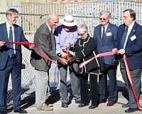 REVIEW PHOTO: GARY M. STEIN - Cutting the ribbon on the new Warner Hall, from left: state Treasurer Ted Wheeler, Lake Oswego Mayor Kent Studebaker, Bill and Barbara Warner, Lakewood Board President Don Irving and Lakewood Executive Director Andrew Edwards.