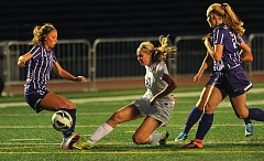 VERN UYETAKE - Lake Oswego's Emily Elott slides to knock the ball away from Sunset during the Lakers' 0-0 draw at home on Monday.