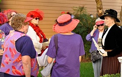 PAMPLIN MEDIA GROUP: LESLIE PUGMIRE HOLE - Willamette Historical Society President Beth Smolens chats with members of a local Red Hat Society, there as audience members for the Living History Tour Sept. 19 in West Linn.