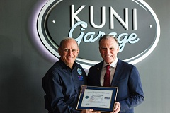 COURTESY KUNI AUTOMOTIVE - Art McCallum, ESGR Area Chair for Portland & SW Washington (left) presents Kuni CEO Greg Goodwin with his award.