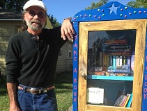 LEXIE TOMBLESON - Mic Tipitino stands next to his Free Little Library on Southwest Deer Street.