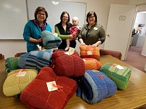 CONTRIBUTED PHOTO - Snow-Caps Executive Director Judy Alley, far left, and agency staff receive donated blankets, which are needed by low-income folks in East Multnomah County.