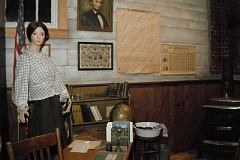 IRIS RILEY - Muralist Victoria Knight painted the walls and floor to look realistically like those of an old schoolroom in the new exhibit at Dibble House Museum Complex in Molalla