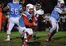 THE OUTLOOK: DAVID BALL - Centennial quarterback Trevor Thornton rolls away from the pressure and escapes the pocket. He had a 15-yard run in the second quarter for the Eagles only points.
