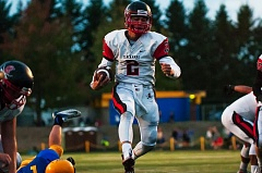 OUTLOOK PHOTO: JOSH KULLA - Clackamas quarterback Wyatt Hutchinson scores a first half touchdown in the Cavaliers' 31-19 win Friday at Barlow High School.