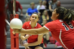 THE OUTLOOK: DAVID BALL - David Douglas setter Jazmine Thompson watches as Amiyah Shakoor reaches out to bump a ball in the front row Tuesday in Oregon City.