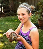 DAVID F. ASHTON - Woodstocks Lucy Ferguson shows off the star of her award-winning video - a Russian tortoise named Francisco.