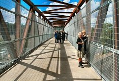 DAVID F. ASHTON - First-time visitors enjoy the view from deck of the new Rhine-Lafayette Pedestrian Overpass.
