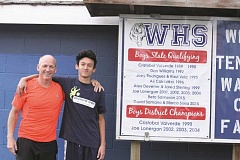 PHIL HAWKINS - Woodburn boys tennis coach Tom Lonergan (left) stands with Beto Salmeron (right), who was one of three Bulldogs to qualify for the state tennis tournament last season.