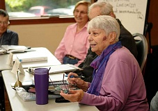 REVIEW PHOTO: VERN UYETAKE - Louise Lowe facilitates a weekly current events discussion at the Lake Oswego Adult Community Center through Portland Community Colleges Senior Studies Institute.
