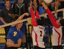 THE OUTLOOK: PARKER LEE - Barlows Megan Sesters puts a ball over the net during the Bruins five-set win over Clackamas on Tuesday.