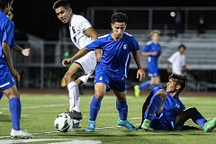 HILLSBORO TRIBUNE PHOTO: AMANDA MILES -  Glencoe's Argel Alfaro (6 in white) battles for possession of the ball with Hillsboro's Roberto Mora while Nazario Velazquez looks on from the ground on Wednesday night at Hare Field. The city rivals both remained undefeated with a 1-1 draw.
