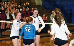 PAMPLIN MEDIA GROUP: SETH GORDON - Members of the Sherwood High School volleyball celebrate during the team's match at Newberg last week. The Lady Bowmen came away with a 3-1 victory.