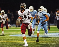 PAMPLIN MEDIA GROUP: VERN UYETAKE - David Morris scored three touchdowns for the Bowmen in their 35-3 victory at Lakeridge on Friday