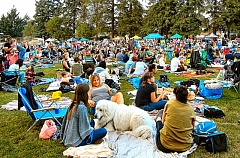 ELIZABETH USSHER GROFF - People sprawled out in Woodstock Park on that midsummer evening, waiting for dusk - and the start of this years Movie in the Park, The Never Ending Story. The turnout this year was acclaimed as the biggest yet.