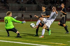CHRISTOPHER OERTELL - Oregon City senior Nicholas Slaughter (7) goes on the attack in last weeks 6-0 rout of Southridge.