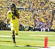 TRIBUNE FILE PHOTO: JAIME VALDEZ - Taj Griffin's running complemented the work of Royce Freeman in the Oregon Ducks backfield on Saturday night as the Ducks got past Colorado 41-24 at Boulder.