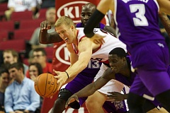 TRIBUNE PHOTO: JAIME VALDEZ - Mason Plumlee, starting at center for the Trail Blazers,  reaches for a rebound against Sacramento guard Darren Collison during Monday night's NBA exhibition opener at Moda Center.