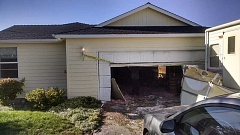 CONTRIBUTED BY CCFR - This Southeast Knowledge Street home was unoccupied when the garage fire erupted Tuesday.