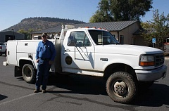 CONTRIBUTED PHOTO - Post ranch manager Gary Wilhelm stands with 'Whitey,' his Post-Paulina Rangeland Fire Protection Association firetruck. Wilhelm took over the leadership of the local RFPA this summer.