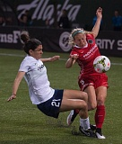 TRIBUNE FILE PHOTO: JOSH KULLA - Portland Thorns defender Kendall Johnson (right) battles for the ball in a game against the Washington Spirit.