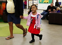 TRIBUNE PHOTO: JONATHAN HOUSE - Clarendon preschooler Lilibeth Castrejon Pantoja smiles as she approaches her preschool class at Clarendon Regional Early Learning Center.