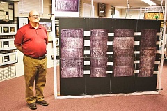 POST PHOTO: KYLIE WRAY - Bob Stancell, Oregon City resident and minister at the Church of Christ in Sandy, has arranged his personal collection of bible history into an exhibit in Sandy.