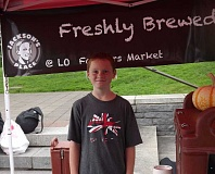 SUBMITTED PHOTO - Jackson Ryan (shown here in 2012) sells coffee at his family's stand, Jackson's Place, every week at the Lake Oswego Farmers' Market.