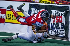TRIBUNE FILE PHOTO: JOHN LARIVIERE - Perez Ashford, one of eight players whose options were picked up Wednesday by the Portland Thunder, dives for extra yardage after a reception versus the Los Angeles KISS last season.