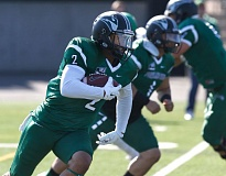TRIBUNE PHOTO: JONATHAN HOUSE - Paris Penn, a multiple position player for Portland State who is from Grant High, picks up yardage in last week's home game versus North Dakota. Despite a 19-17 loss, the Viks remained in the FCS rankings, checking in at No. 25 this week.