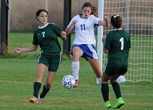 LON AUSTIN/CENTRAL OREGONIAN - Scout Wagner plays the ball away from the Crook County goal in the second half of the Cowgirls' 4-0 loss to Estacada last Thursday.