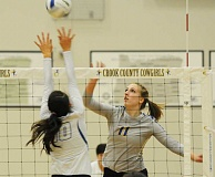 LON AUSTIN/CENTRAL OREGONIAN - Jennifer Roth tips the ball for a kill against Madras on Thursday. Roth led the Cowgirls in kills in the match with 13. The following night she had 22 kills as the Cowboys defeated the Estacada Rangers.