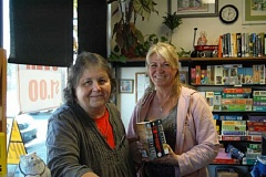 ESTACADA NEWS PHOTO: EMILY LINDSTRAND - Book Nook manager Linda Arnett and volunteer Sheila Laverty are excited about the start of the store's dollar sale.