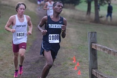 PAMPLIN MEDIA GROUP: PARKER LEE - Parkrose High's Abdiweli Mohamed, a senior, races to fifth place -- his best finish of the season -- in a five-way cross country meet at Sandy.