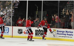 COURTESY: BRYAN HEIM/PORTLAND WINTERHAWKS - Keegan Iverson (right) celebrates his first goal of the season, as the Portland Winterhawks defeat the Spokane Chiefs 5-0 Friday night at Moda Center.