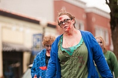 OUTLOOK PHOTO: JOSH KULLA - Dozens of enthusiasts of all ages dressed as zombies made their way through downtown Gresham Saturday during the first ever Gresham Zombie Walk.