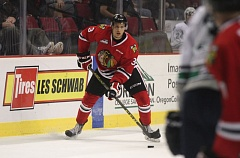 COURTESY: BRYAN HEIM/PORTLAND WINTERHAWKS - Defenseman Caleb Jones controls the puck for the Portland Winterhawks in Sunday night's 3-2 loss at home to the Seattle Thunderbirds.